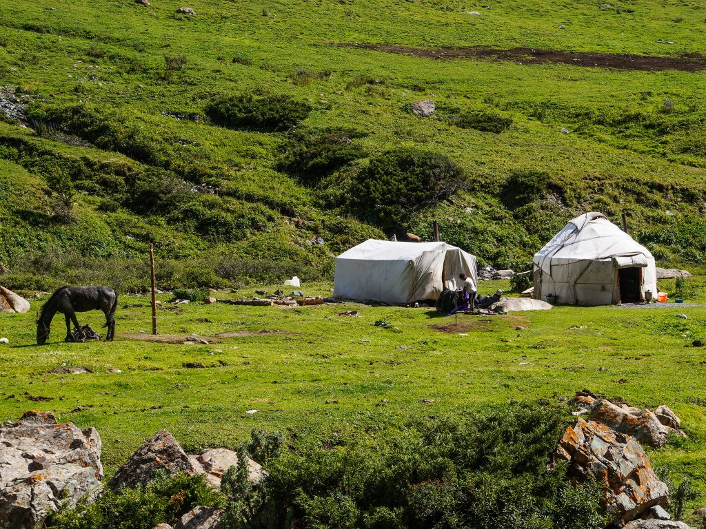 Yurt and nomad in Kyrgyz Mountains