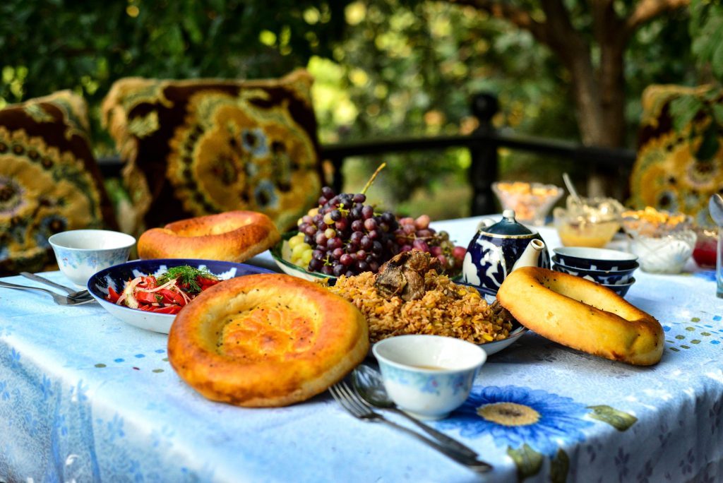 feel the true atmosphere of Central Asia by eating plov in a cozy garden