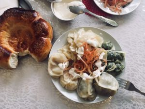 Assorti of mantys including maida-manty, pumpkin manty and green pelmeni